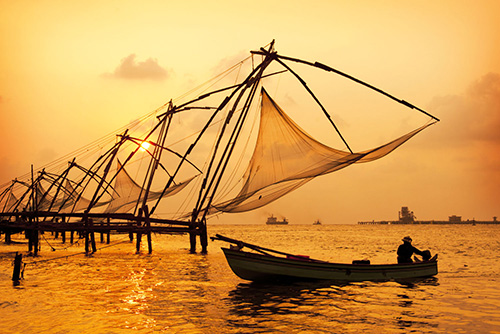 Sunset-over-Chinese-Fishing-nets-and-boat-in-Cochin-Kochi-Kerala-India-shutterstock_1041711291